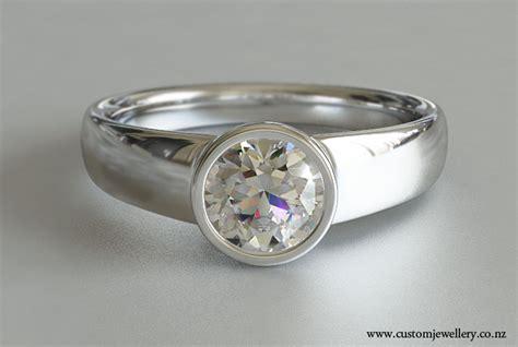 brilliant cut diamond solitaire engagement ring rub over