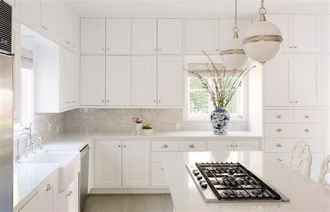 dove gray subway tiles  white shaker cabinets