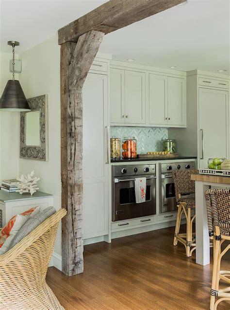 kitchen  ovens cream cabinetry butcher block