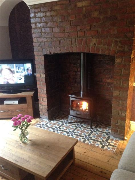 wood burning stove and tiled hearth is a tiger classic stove and tiles are from a6 tiles