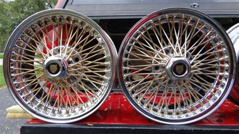 buy wire wheels daytons  xj jaguar gold nipples