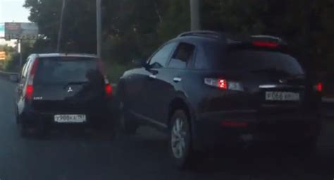 Infiniti Suv Almost Mounts Small Car, Runs From Accident