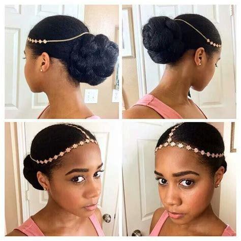 low bun with kanekalon braiding hair protective style
