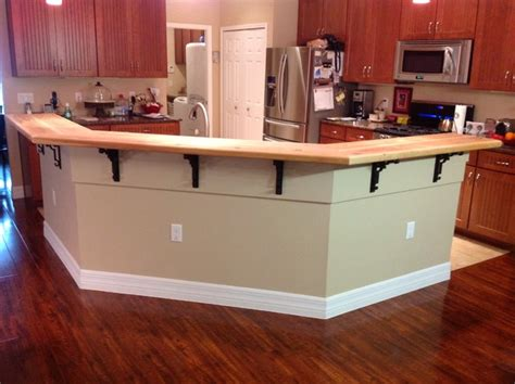kitchen island with bar top kitchen island bar top traditional kitchen ta by master carpentry repair