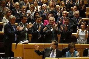 The Latest: Opposition walks out of Catalan parliament ...