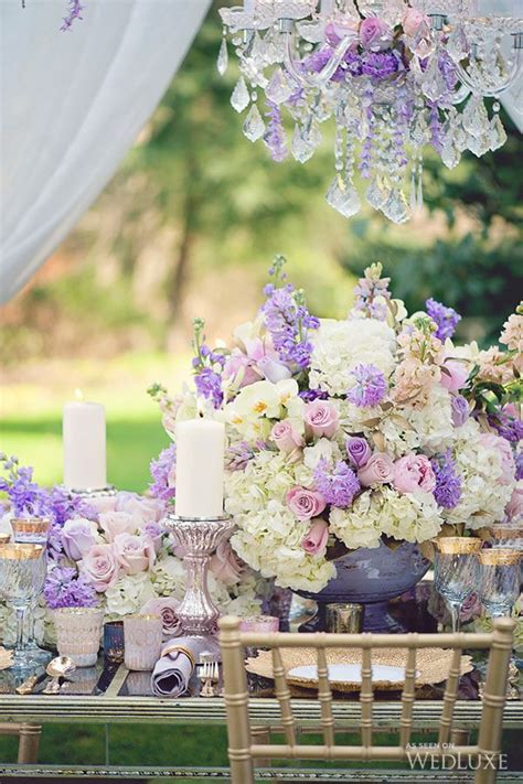 floral tablescape centrepiece with candles lilac wedding centerpieces low