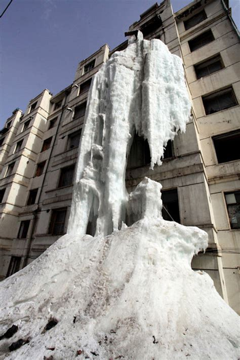man creates ice waterfall   side  apartment