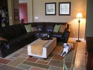 Decorating with leather sofa mirror hardwood floors for Decorating with brown leather couches