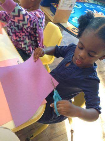 meet the directors amp teachers at cadence academy preschool 733 | preschool girl cutting construction paper at cadence academy preschool franklin tn 336x450