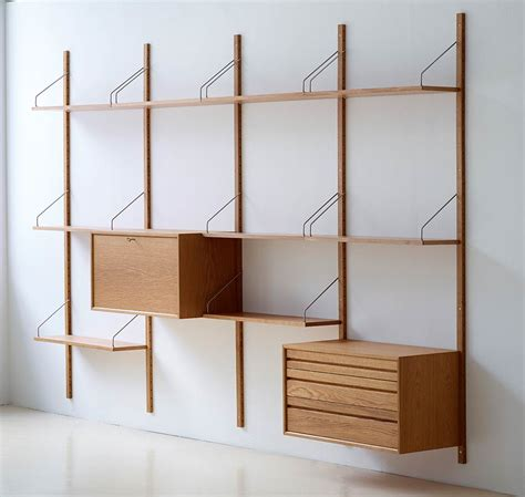 midcentury modern bookcase display shelf walnut wood royal system shelving designed by poul cadovius in 1948