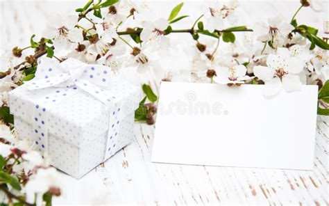 spring flowers  gift box  empty tag stock photo