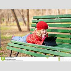 Little Girl Learning With Tablet Pc In The Park Stock Photo  Image 34931912