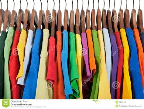 Variety Of Multicolored Clothes On Wooden Hangers Stock