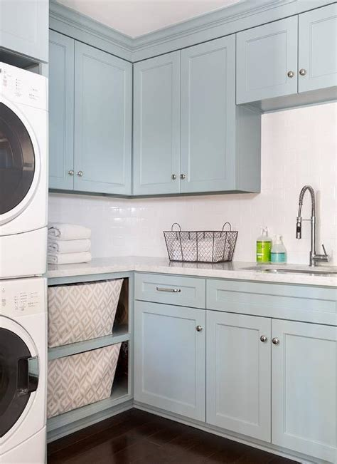 blue laundry room cabinets  carrera marble