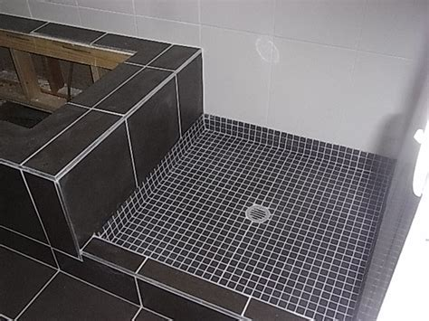 wall and floor tiling tiled shower base with a hob