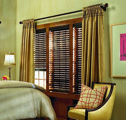 green  gold bedroom design  dark wood blinds