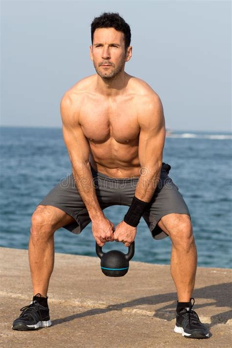 kettlebell lifting naked seaside swinging preview
