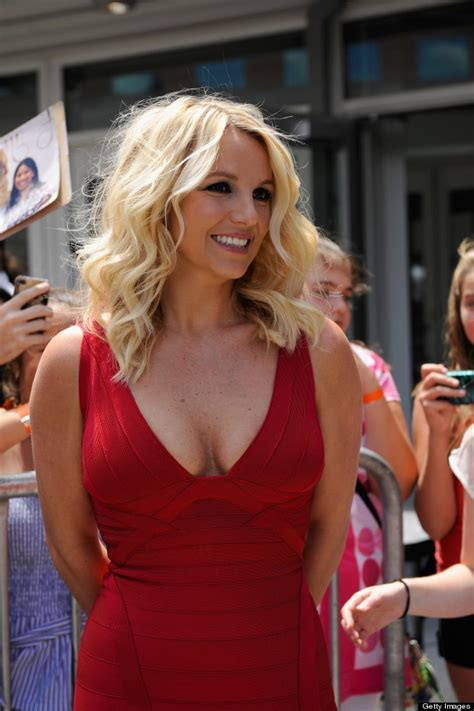 Britney Spears Flaunts Her Assets In Curve Hugging Red Hot