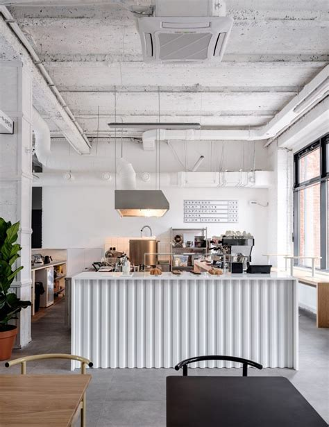 Coffee shops designed with great architecture and interior designing can make one lose track of time. Asketik creates stark white coffee shop in Soviet silk factory | Cafe interior design, Cafe ...