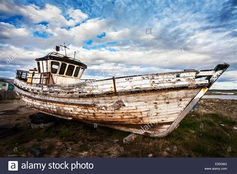 Old Boat Junk Yards old boat on abandoned junk yard stock photo royalty free