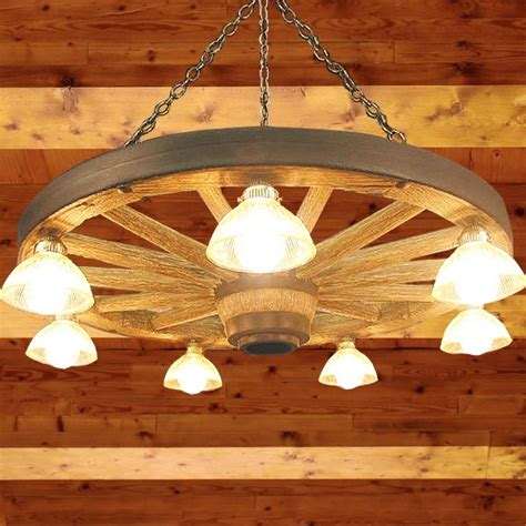 wagon wheel lights wagon wheel chandeliers cabin place