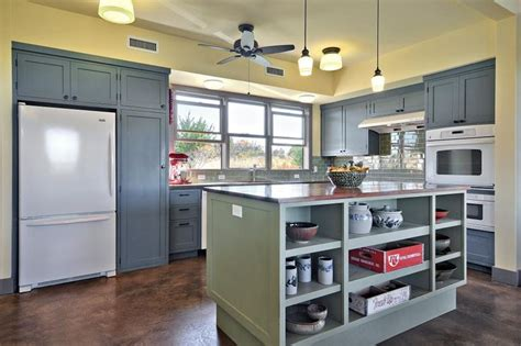 green kitchen cabinets with white appliances dusty blue cabinets and a green kitchen island
