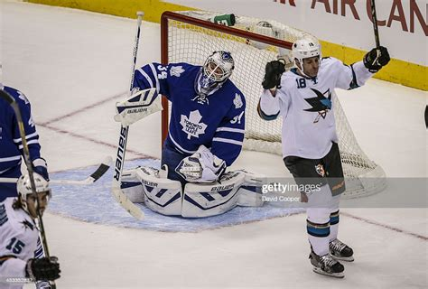 Toronto maple leafs goalie jonathan bernier reacts after mishandling the puck and allowing a new york islanders goal during second period nhl action in toronto on tuesday, january 7, 2014. TORONTO, ON- DECEMBER 3 - Toronto Maple Leafs goalie James ...
