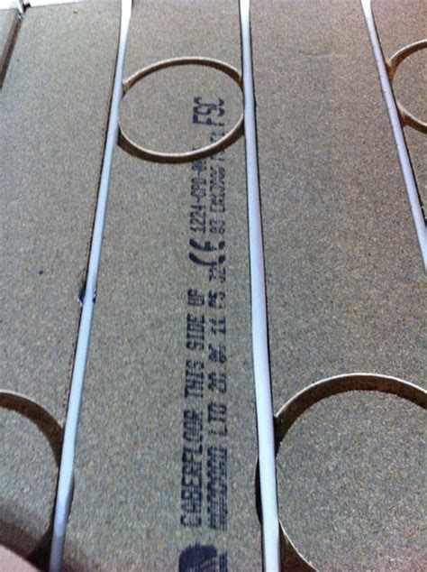 Underfloor heating compatible strand woven bamboo flooring