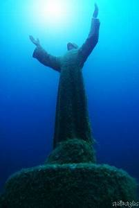 Diving to an underwater statue near PortofinoChrist of