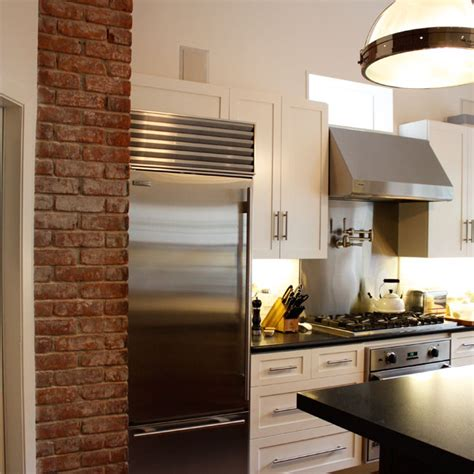 kitchen  exposed brick transitional kitchen