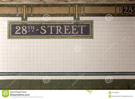 new york city station subway 28th sign on tile wall