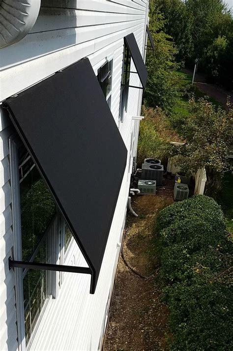 commercial awning welded frame window awning leola village black sunbrella window