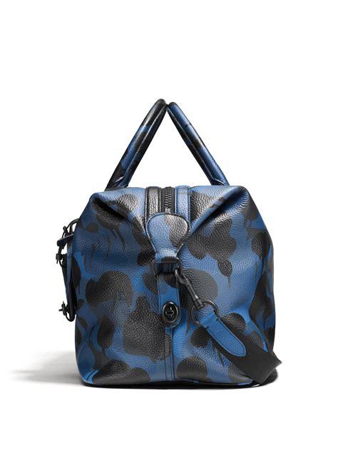 coach explorer camo print leather duffle bag  blue lyst