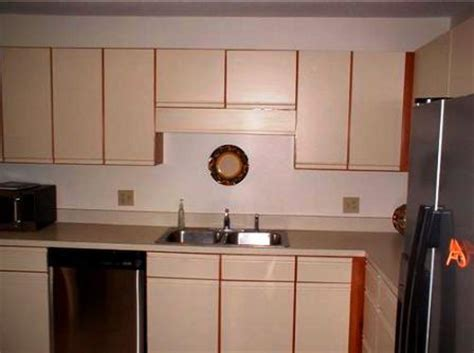 painting 1980s kitchen cabinets home staging tip for those 80s kitchen cabinets 4008
