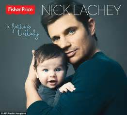 Nick Lachey tenderly cradles his blue-eyed boy Camden for ...