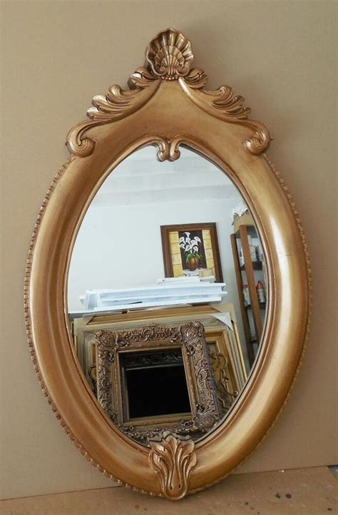 large gold ornate hard resin  oval framed wall