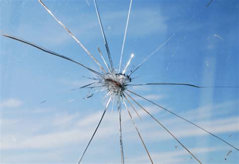 truck kicks   rock shattering  windshield  pays