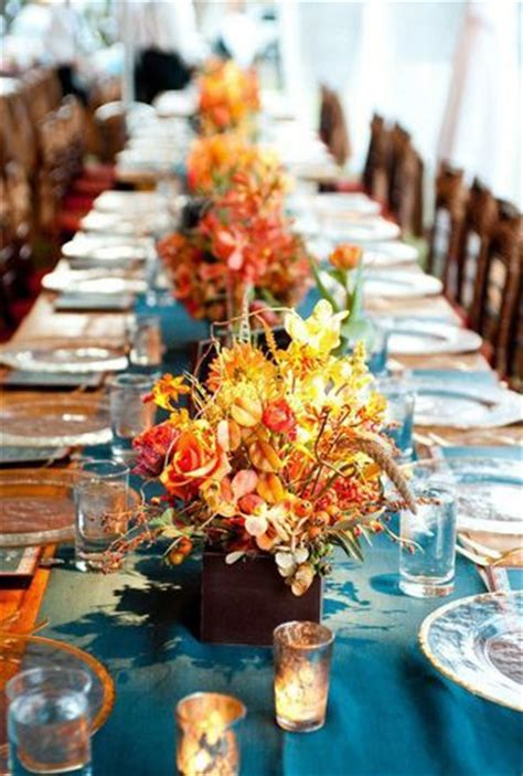 teal orange  yellow reception table setting fall  pantone color report biscay bay