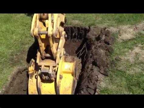 backhoe digging youtube