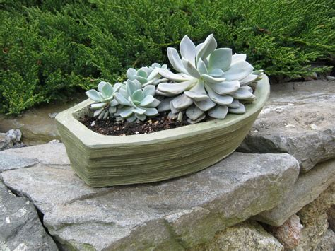 How To Build A Boat Planter by Boat Planter Concrete Green Boat Plant Pot Flower Pot Boat
