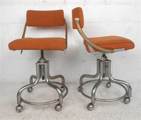 pair of midcentury rolling chairs by domore for sale at