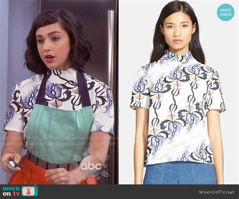 Mandy's printed mock-neck top and mint/orange apron on ...