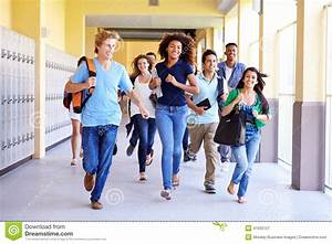 Group Of High School Students Running In Corridor Stock ...