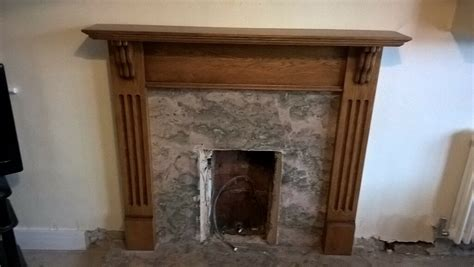 composite fireplace oak mantel and marble composite hearth surround in