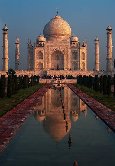 fiery fantasy  taj mahal reflected   fountain