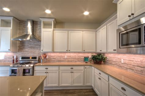 salmon colored kitchen white kitchen cabinets with salmon color tile back splash 2092