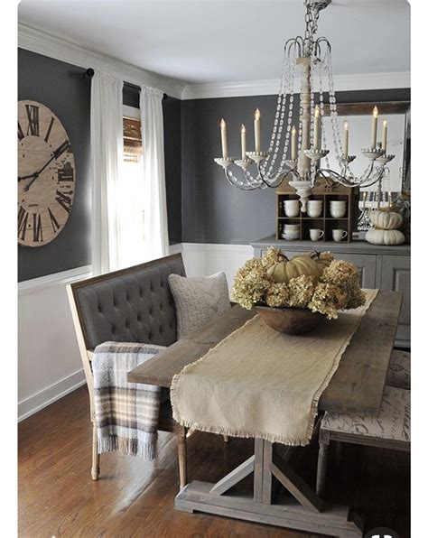 A solid wood dining table and upholstered chairs. Rustic Glam dining | Farmhouse dining rooms decor, Modern farmhouse dining room decor, Farmhouse ...