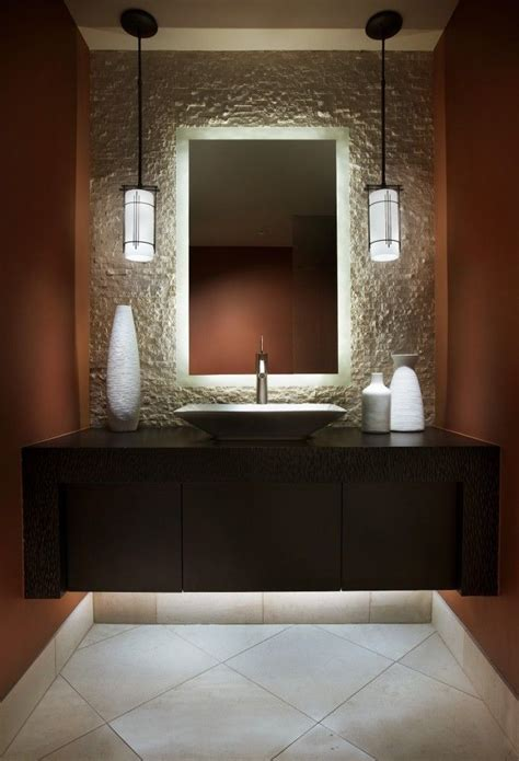 create powder room drama with lighting the mirror is backlit and highlights the texture of the