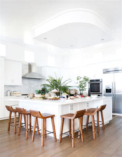 large white kitchen island white kitchen with caramel stained wood floors 6825