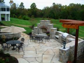Image of: Remarkable Landscape Backyard Patio Idea Pale Brown Stone Element Floor Black Stone Patio Designs As Happiness Resources